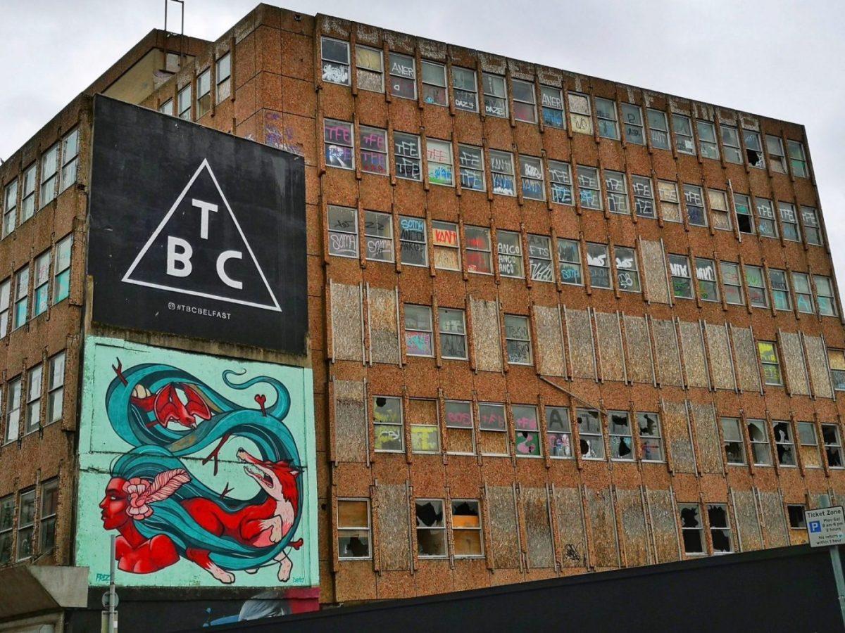 Belfast Street Art - a Dilapidated building with a street art wall