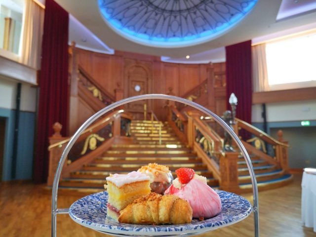 Tasty cakes for afternoon tea in front of the Grand Staircase at the Titanic Museum Belfast