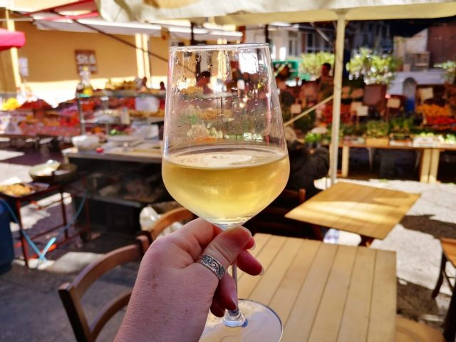 Cheers! A glass of local wine to wash down the street food in Palermo