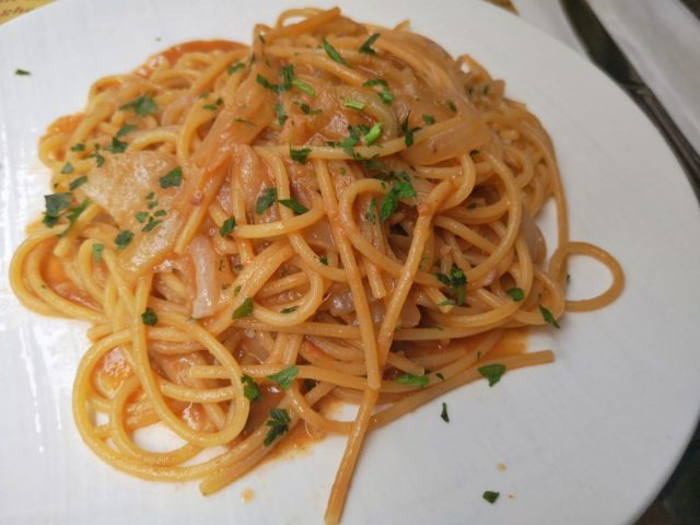 Bigoli in Salsa - What to Eat in Venice - Plate of Spaghetti with a sardine sauce