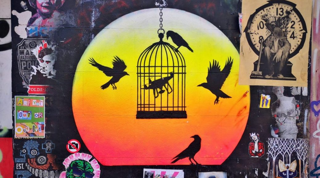 Keep An Eye out for Cool Street Art all around Brick Lane - A Drone inside a bird cage with birds flying outside the cage