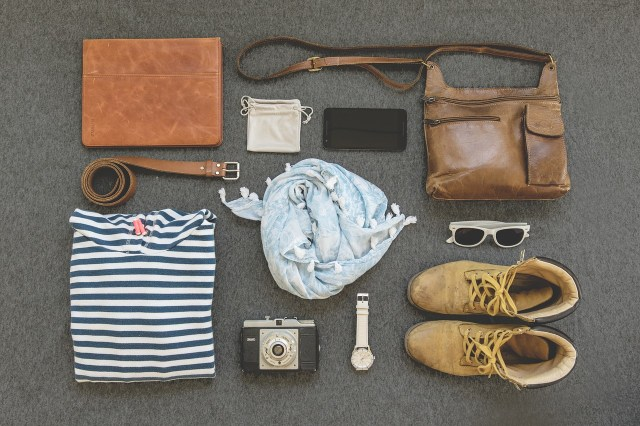 Flatlay of items to pack for backpacking on a budget