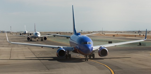 Aeroplanes Queuing Up to Fly - How to Reduce Your Carbon Footprint of Flying