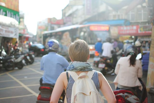 Solo female traveller in a busy street