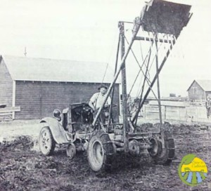 "One of the Schlothauer boys with his invention the ""Front Loader"""