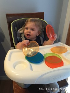 Playing with lids is a great high chair activity.