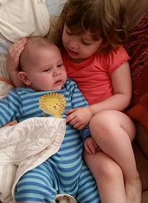 Fidget & Little Man cuddles time. From Tales of Two Children a parenting and family style blog. Come visit us at TalesofTwoChildren.com