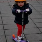 Fidget ploughing her way on her Mini Micro Scooter.