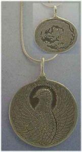 dragon and phoenix silver pendant