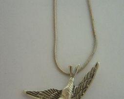 colgante golondrina amuleto de plata