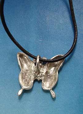 colgante mariposa plata tras