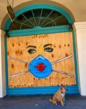 Sunday, May 3, 2020 – French Quarter walk and woman in mask COVID-19 graffiti on plywood by artist Josh Wingerter. New Orleans, LA. Christine Miller