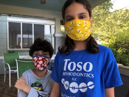 Saturday, April 11, 2020 – Trying on their cloth masks. New Orleans, LA. Stephanie Hepburn