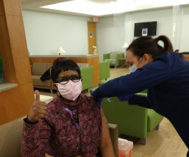 """Wednesday, January 27, 2021 – Gloria Henderson, MS, CAADC, Recovery Navigatory at RI International, gets her first dose of the Moderna vaccine at St. Francis Hospital in Wilmington, Delaware. """"It was simple and easy to know that change is ever-present,"""" says Henderson."""