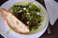 a simple salad with goat cheese, walnuts and cranberries