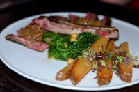 Bone-in Rib Eeye with triple-fried potatoes at the Sign of the Whale