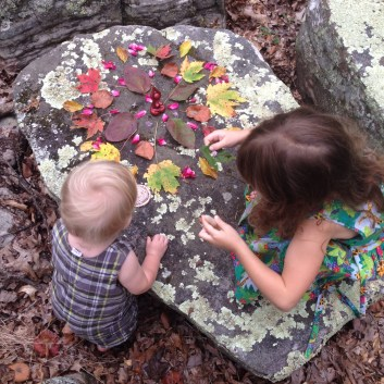 Helping with a fall nature mandala