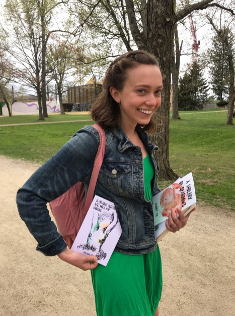 Kane on Kenyon College campus with book in her right hand. Photo courtesy of Virginia Kane.