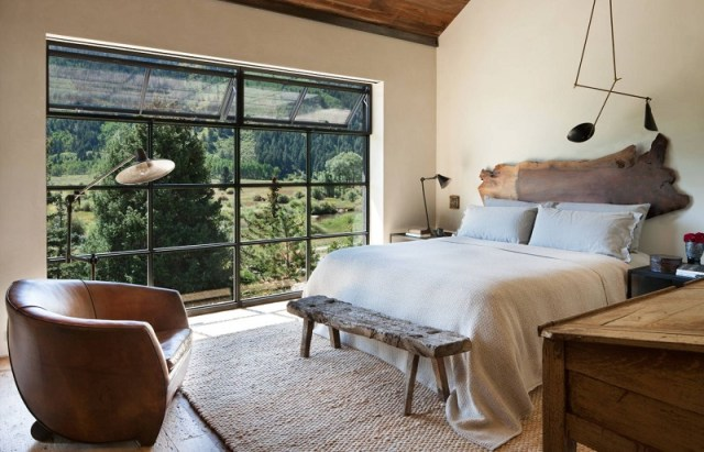 Master Bedroom With Large Windows Leather Armchair And Live Edge Headboard