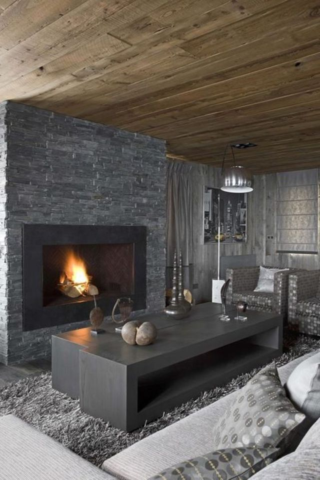 Masculine Living Room With A Stone Clad Fireplace