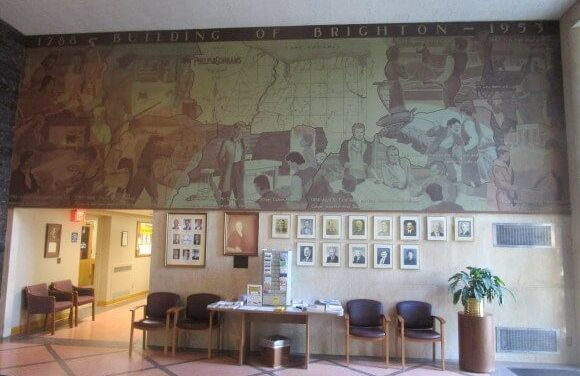 At the Brighton Town Hall 1957 mural with Sandra Frankel