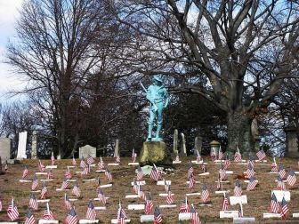 Hiker statue in North Burial Ground, Pawtucket, RI>