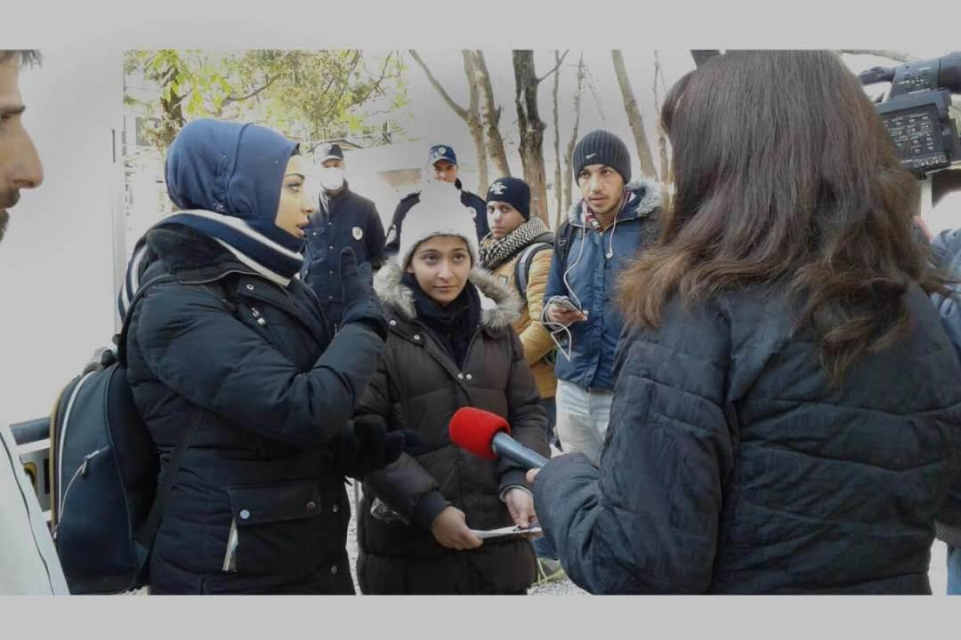 girls being interviewed by Greek TV
