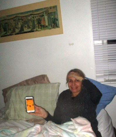 6. Leslie in natural state with phone