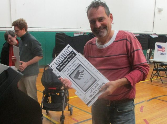 """My vote: # 104 at this machine. Election Monitor Jim Harald kindly took the photo and gave me an """"I Voted"""" sticker."""