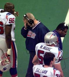 New England Patriots coach Bill Parcells buries his head in his hand on the sideline at the end of second quarter of Super Bowl XXXI against the Green Bay Packers at the Superdome in New Orleans Sunday, Jan. 26, 1997. (AP Photo/J. Scott Applewhite)