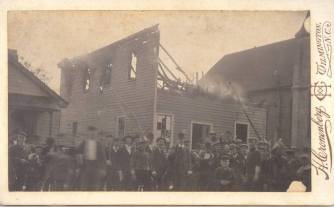 A group of men stand in front of the destroyed printing press of African-American newspaper owner and editor Alex Manly on November 10th, 1898. Shortly after this, the race riot broke out in the steets of Wilmington. Henry Cronenberg / New Hanover County Public Library