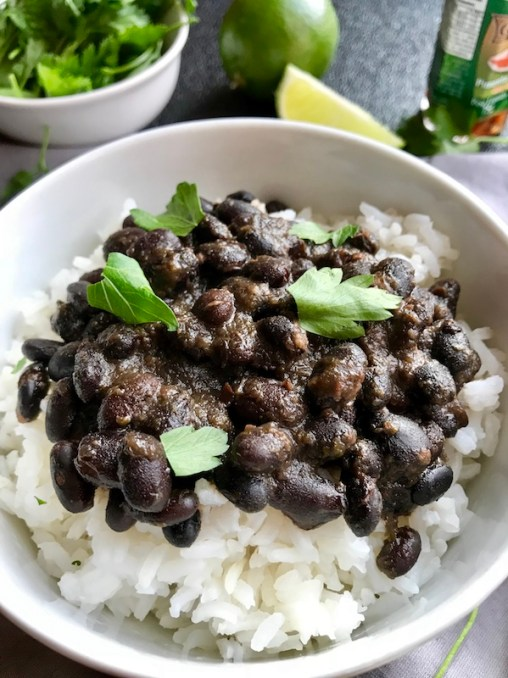 Slow Cooker Brazilian Black Beans are thick, rich, and delicious! Serve as a side or main over rice.