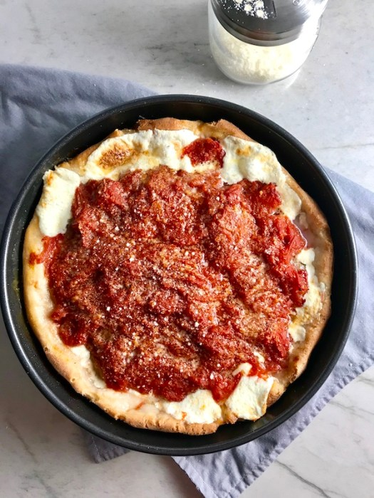 This Chicago Style Pizza is a lighter and healthier version, but still AMAZING! It still has all of the gooey mozzarella cheese, but uses homemade turkey Italian Sausage, that's so delicious!