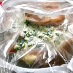 Raw chicken and yogurt marinade in bag for Cilantro Lime Yogurt Chicken, Peppers & Broccoli.