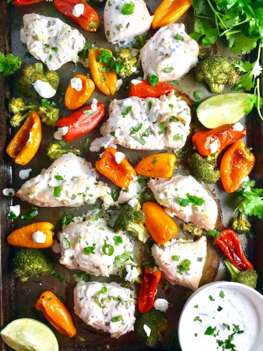 Cilantro Lime Yogurt Chicken, Peppers & Broccoli on a pan with sauce