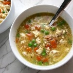 5-Ingredient Chunky Chicken Vegetable Soup in a bowl on counter with spoon in bowl. It's creamy (but there is no dairy!) and chunky, and delicious! With loads of chicken, carrots, and peas.