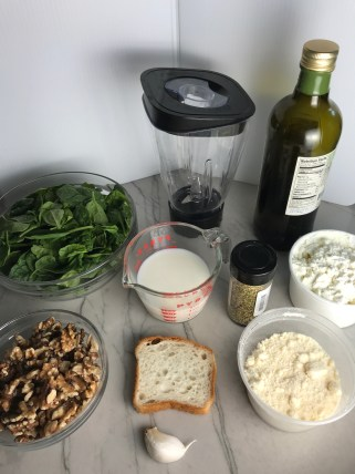 Ingredients for this Walnut Sauce recipe with Ricotta and Spinach. It is thick, rich, nutty, and creamy. It's inspired by the traditional Italian Walnut Sauce from the North-Western Italy, Liguria Region, but my Walnut Sauce recipe adds even more decadence with creamy ricotta and more nutty parmesan cheese.