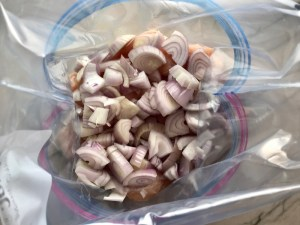 Chopped Shallots added to bag with chicken for Freezer Hoisin Chicken with Red Peppers, Carrots, Onions, Ginger, and Soy sauce is delicious and so easy to make. You get sweet and savory all in one dish and it's perfect for kids because it's sweet, not spicy at all. Just freeze ahead, thaw, then cook on a sheet pan!