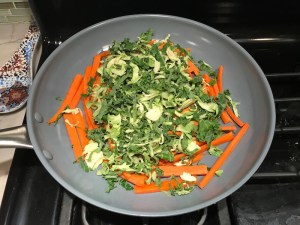 Carrot and Brussel Sprout slices in pan for Asian Lettuce Wraps. They are a fantastic way to use leftover Turkey or Chicken transforming it with new delicious flavors and textures. The turkey is stir fried with carrots, red pepper, and brussel sprouts in a flavorful ginger, garlic, & sesame sauce. It's layered in lettuce wraps with rice and a cool, crunchy purple cabbage sesame slaw. Serve with a Garlic Honey Soy Sauce....YUM!!!