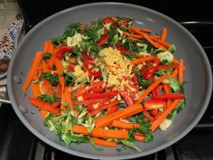 Stir Fry Vegetables and Ginger in pan for Asian Lettuce Wraps. They are a fantastic way to use leftover Turkey or Chicken transforming it with new delicious flavors and textures. The turkey is stir fried with carrots, red pepper, and brussel sprouts in a flavorful ginger, garlic, & sesame sauce. It's layered in lettuce wraps with rice and a cool, crunchy purple cabbage sesame slaw. Serve with a Garlic Honey Soy Sauce....YUM!!!