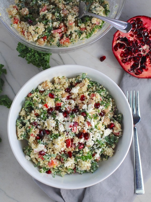 Bowl of Quinoa & Kale Salad with Roasted Chickpeas, Pomegranate, Feta, red pepper, and Creamy Lemon Dressing.#glutenfree #lunch #dinner #healthyrecipes #healthyfood #salads #quinoa #kale