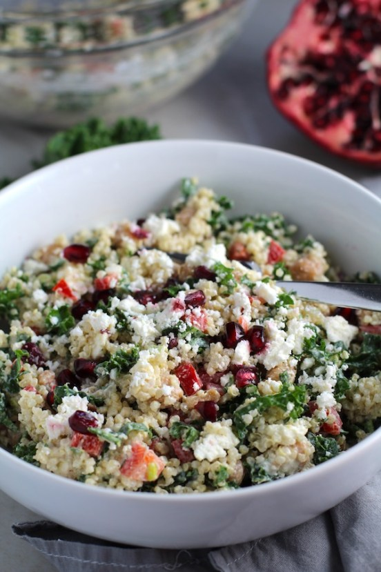 Close up of bowl of Quinoa & Kale Salad with Roasted Chickpeas, Pomegranate, Feta, red pepper, and Creamy Lemon Dressing.#glutenfree #lunch #dinner #healthyrecipes #healthyfood #salads #quinoa #kale