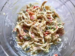 Curry Chicken Salad mixed in bowl. It has so many fantastic flavors and textures!  The chicken breast is simply roasted and mixed with a creamy sweet and savory curry dressing.  Red pepper gives you a fresh crunch, scallion gives a savory bite, and raisins give a burst of sweet.  #chicken #chickenrecipes #chickensalad #currychicken #mealprep #lunch #healthyrecipes
