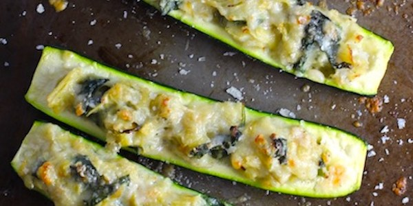 Spinach Artichoke Stuffed Zucchini on a pan. Each fantastic bite gives you creamy artichoke, nutty cheesy Parmesan, spinach, and zucchini. Prepare entirely ahead, then bake 20 minutes and enjoy! #vegetarian #zucchini #stuffedzucchini #spinach #artichoke #springrecipes #healthyfood #healthydinner #healthyrecipes #glutenfree