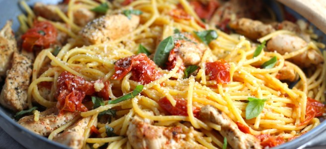 Chicken and Cherry Tomato Pasta with basil and parmesan in a skillet. It's easy and so delicious! #pasta #tomatoes #easydinner #dinner #easyrecipes #healthydinner #chicken