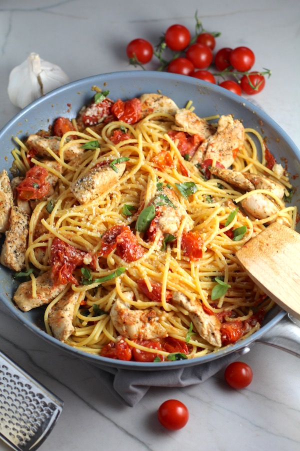 Chicken & Cherry Tomato Pasta in a skillet on counter. One of 10 Must-Try EASY Summer Dinners!