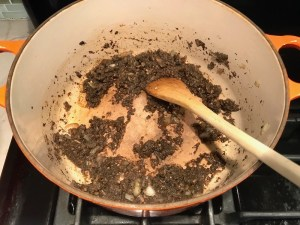Pureed Mushrooms in pot with spoon for Thick & Creamy Healthy Mushroom Soup. The soup has earthy mushrooms, aeromatic onions, flavorful oregano, and bright chives.