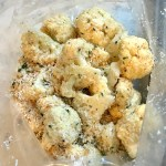 Cauliflower florets mixed with coconut breadcrumbs for Baked Coconut Cauliflower Bites. They have a slightly sweet and salty crunch outside from the shredded coconut and panko mixture.  The inside is soft and creamy.  Dip in the Sriracha Mayo.  Baked, not fried, so healthy!  Easy to make, easy to eat! #cauliflowerrecipes #healthyrecipes #sidedishes #appetizers #healthysnacks