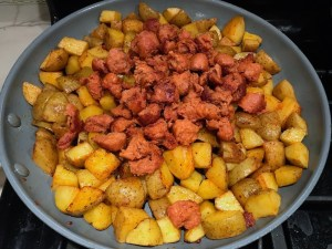 Chorizo and potatoes in skillet for Patatas Bravas with chorizo and creamy Paprika aioli. This Patatas Bravas Recipe, or Spicy Potatoes, is easy, indulgent, and utterly delicious!  #potatorecipes #potatoes #potatosidedishes #patatasbravas #skilletpotatoes #sidedishes #chorizo