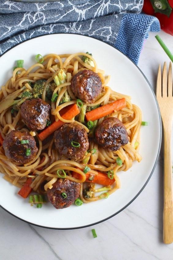 Teriyaki Meatballs with Veggie Stir Fry, and rice noodles on a plate. #asianmeatballs #teriyaki #noodles #familydinner #easydinners #dinnerideas